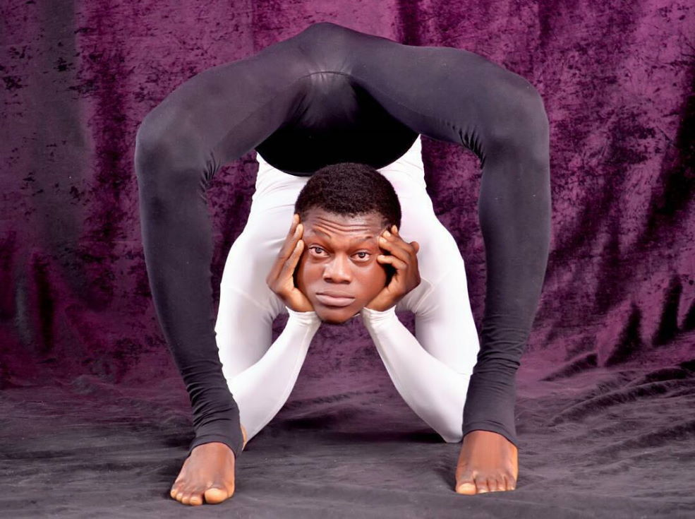a contortionist looking at you thru his legs